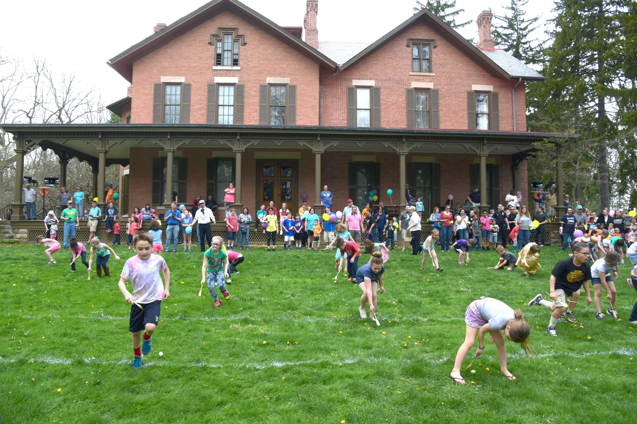 Kids enjoy the annual Easter Egg Roll on the lawn of the historic Hayes Home in this 2017 photo. This year, the egg roll will take place with reduced crowds and numerous safety protocols. (Submitted photo)