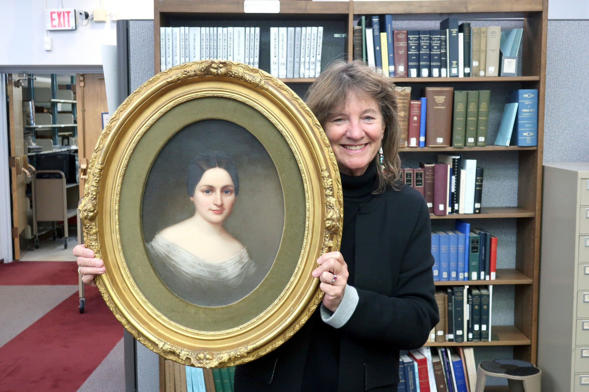 Hayes descendant Lisa Westwater, of Columbus, donates an original painting of Fanny Arabella Hayes, sister of President Rutherford B. Hayes, to the Hayes Presidential Library & Museums. (Submitted photo)