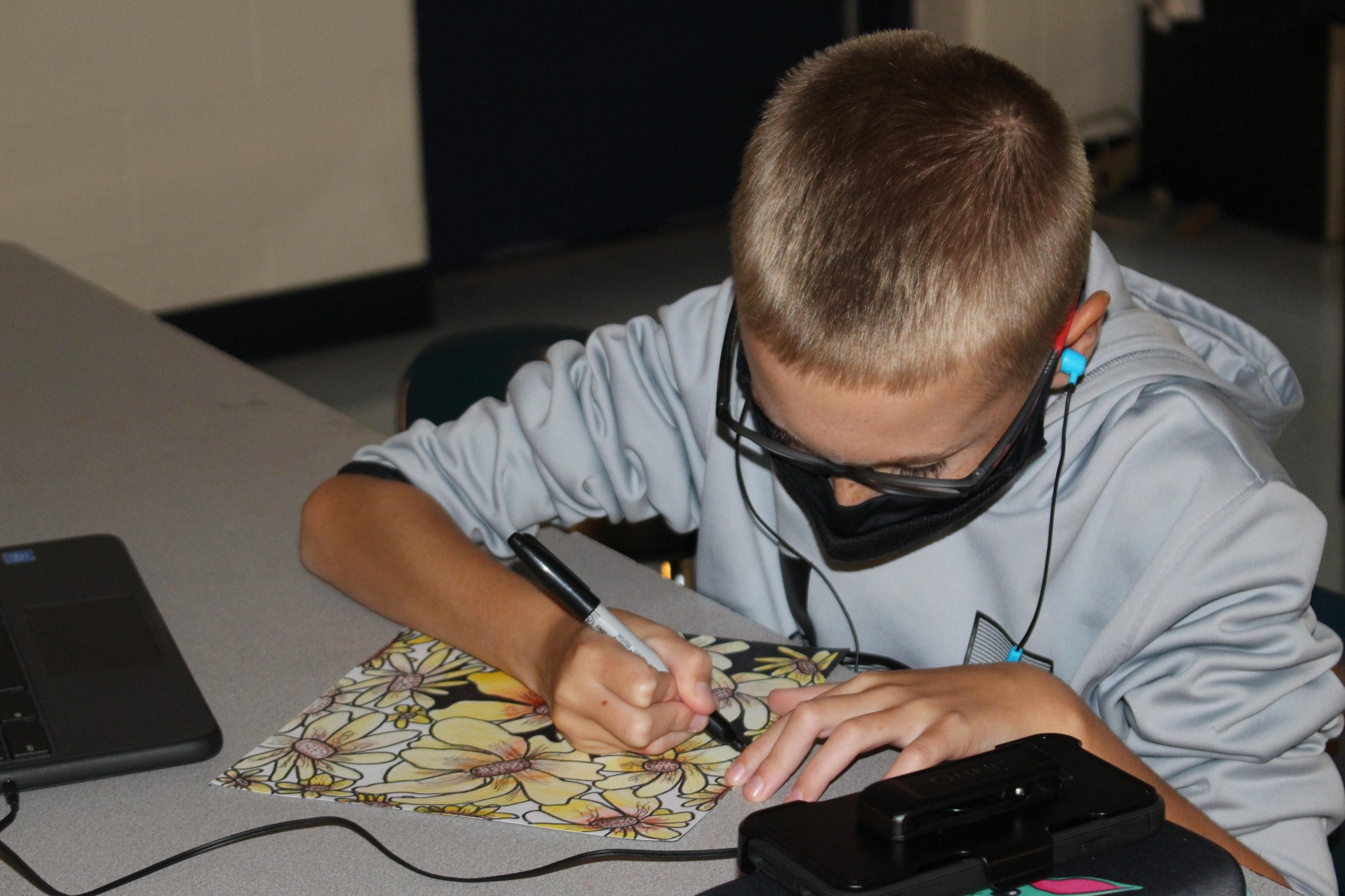 Lake sixth-grader Hunter Lincoln working on Analogous Flowers in art class. (Submitted photo)