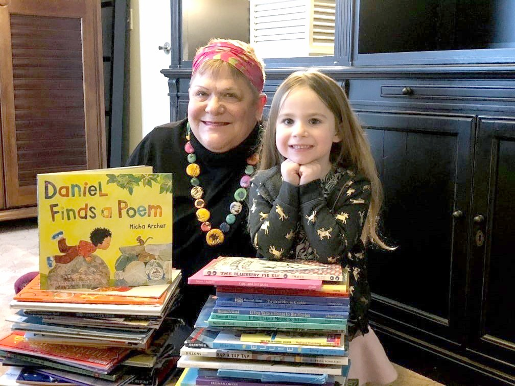 Ottawa County Celebrity Reader Jane Taylor and her granddaughter Alivia enjoy reading 2021 titles from Dolly Parton's Imagination Library. (Submitted photo)