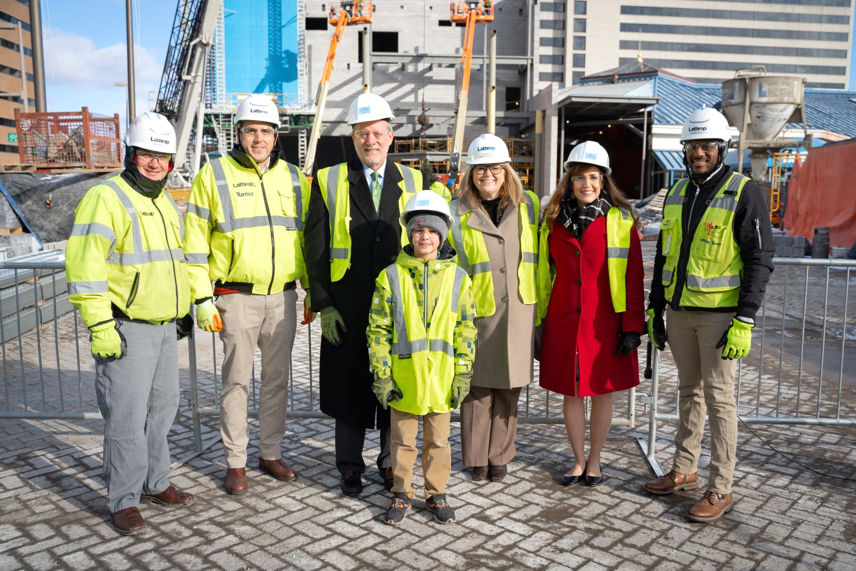 Imagination Station celebrated a major construction milestone on its new KeyBank Discovery Theater Dec. 18. The topping out ceremony commemorated the placement of one of the highest beams in the structural framework for the new addition. (Photo courtesy of Imagination Station)