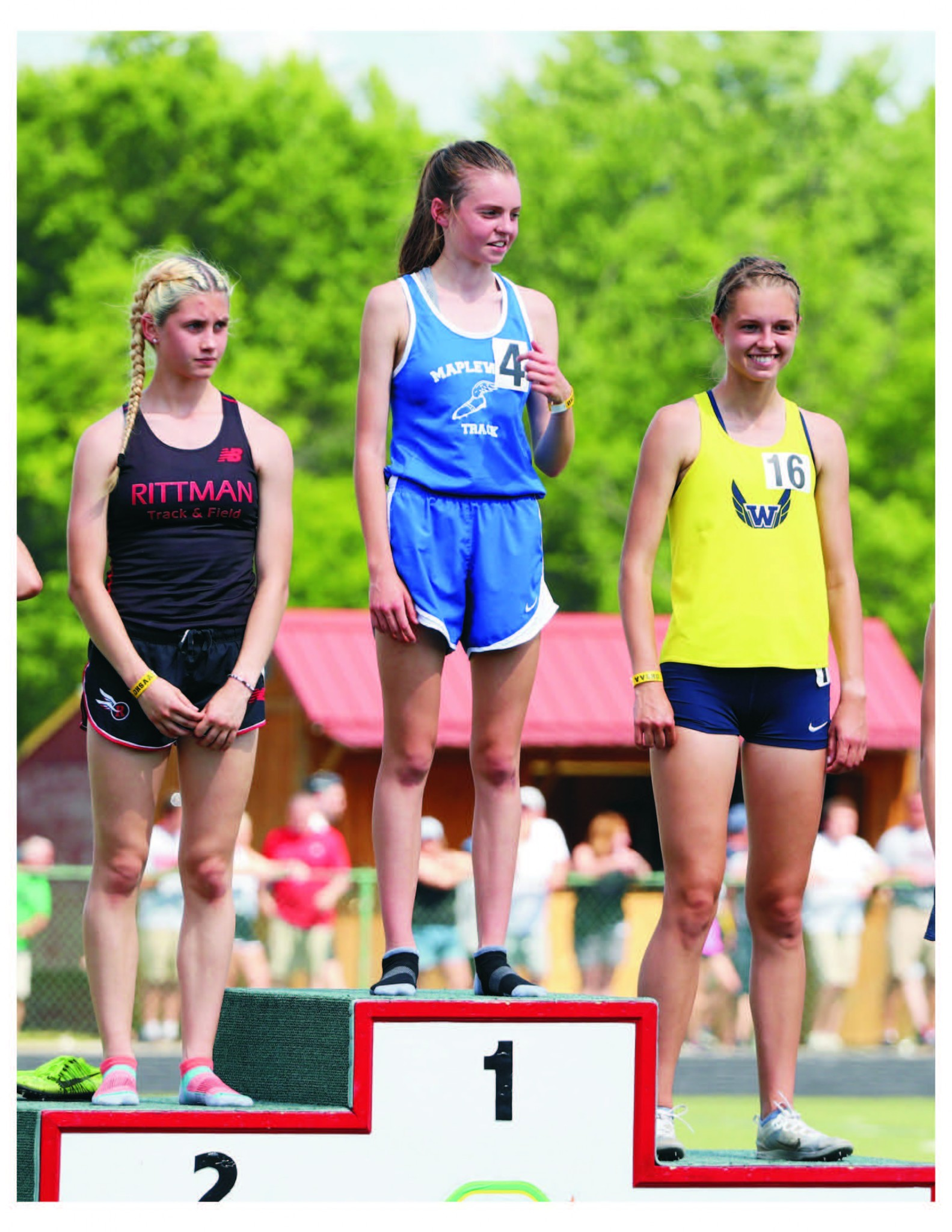 Woodmore senior Ava Beam (right) on the Division III state podium with Mapleton freshman Caleigh Richards placing first (center) and Rittman sophomore Pyper Gibson (left) second. (Photo by Julie Beam)