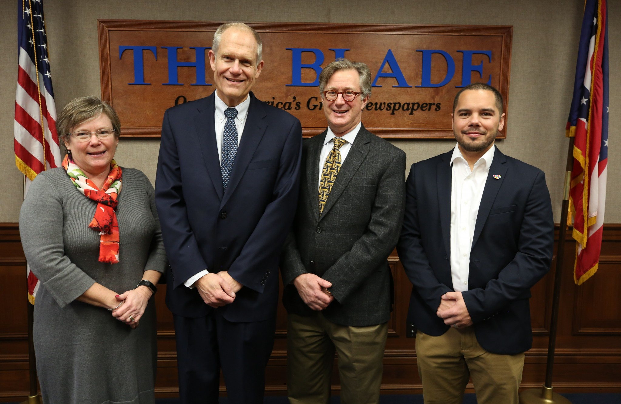 Tami Matthews, interim director of Joyful Connections; Kurt Franck, president and general manager of The Blade; Keith Burwell, president and CEO of the Toledo Community Foundation and Luke Reed, development director of the Autism Model School. (Photo credit: The Blade/Dave Zapotosky)