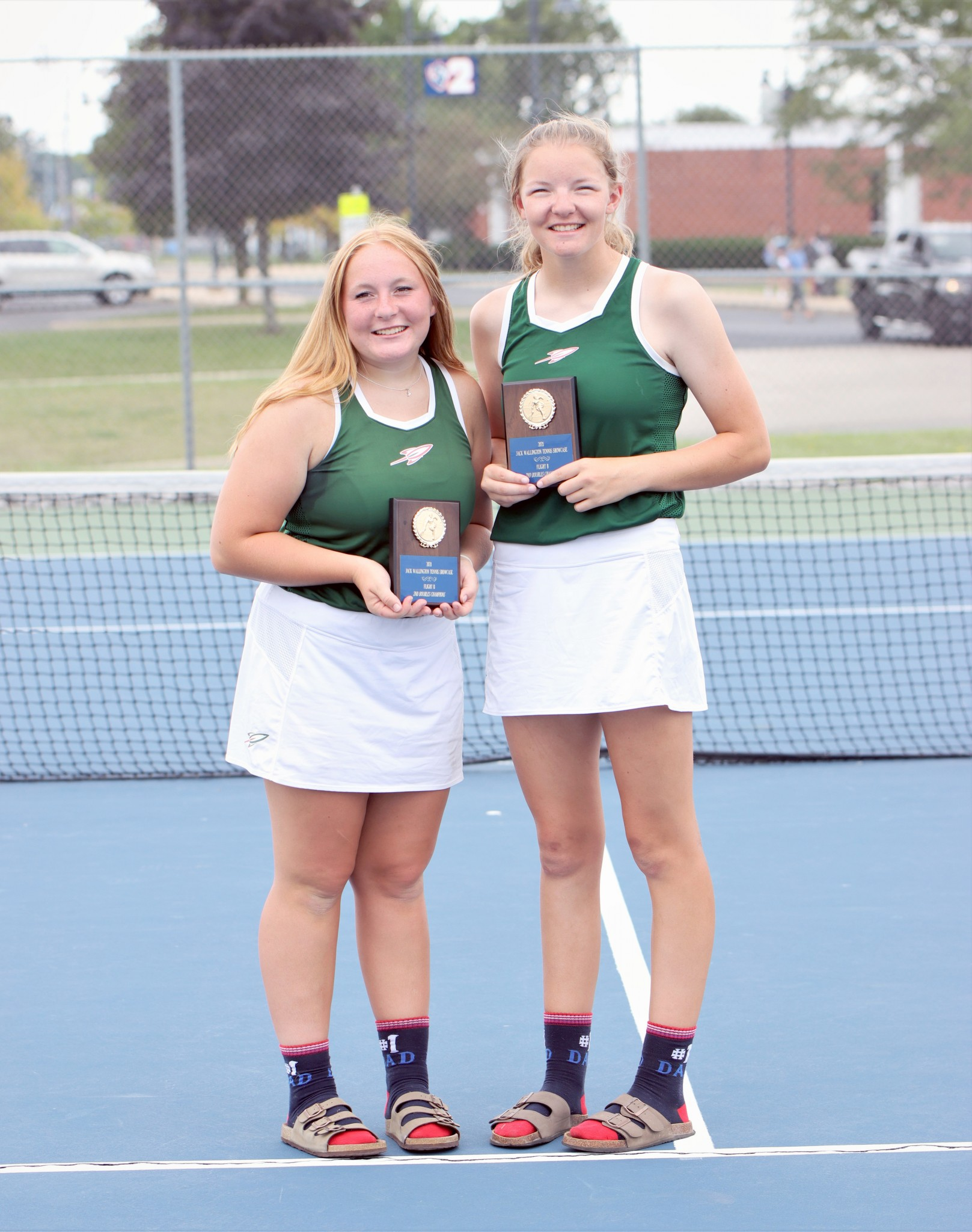 Oak Harbor tennis players Jesse Bolander and Emma Hand. (Photo by Laura Bolander)