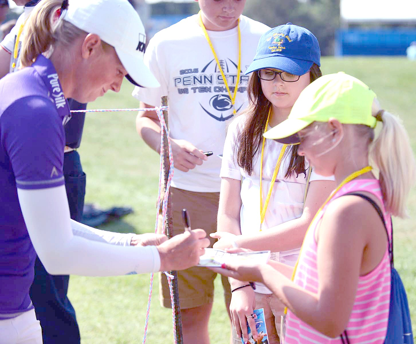 Team USA Assistant Captain Stacy Lewis signs an autograph while here for the Marathon Classic. Team USA is down one match heading into Sunday's play. (File photo by Getty Images courtesy LPGA)