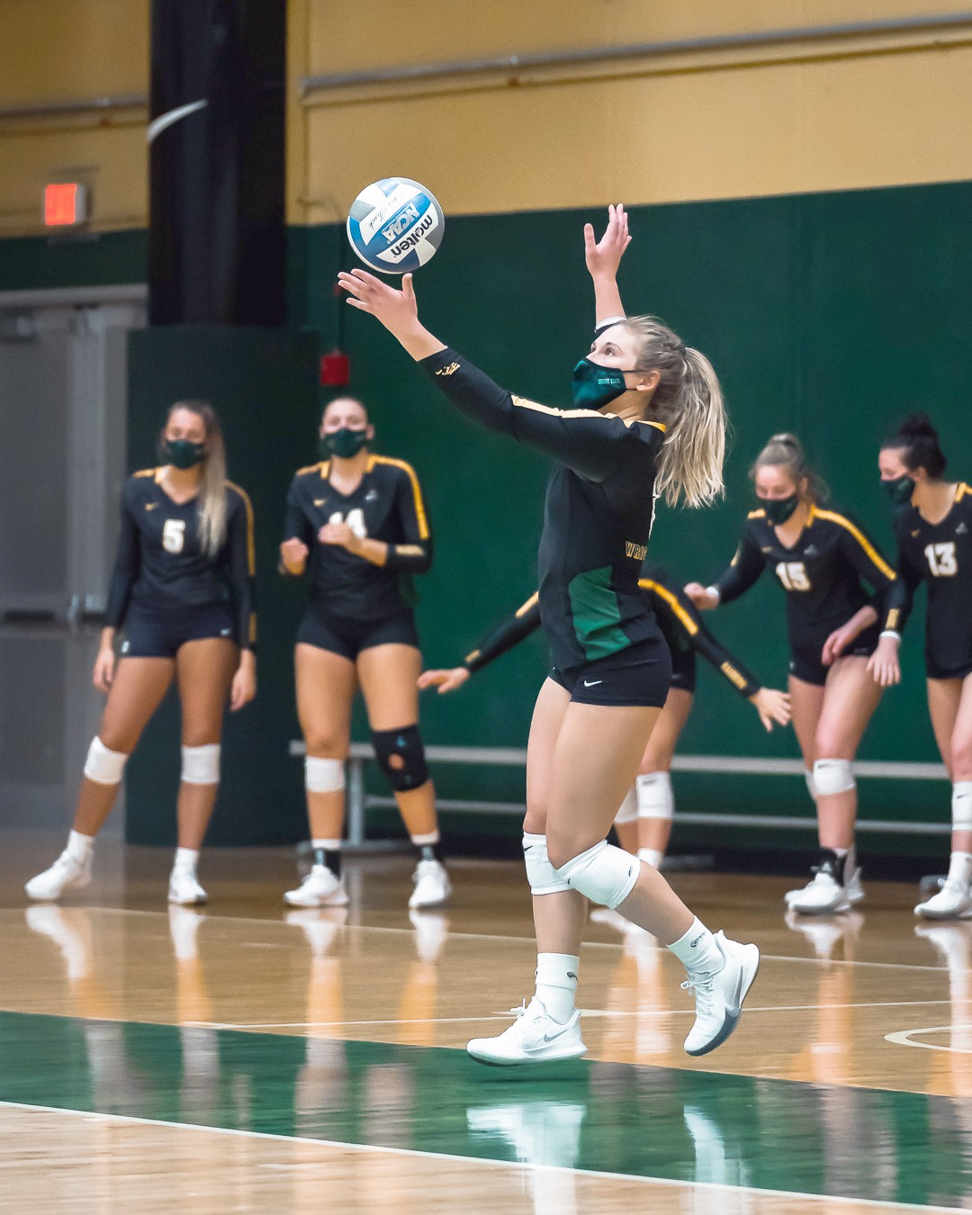 Wright State University senior Mallory Ladd (Clay) works on her serve. (Photo by Matt Barnes/Wright State Athletics)