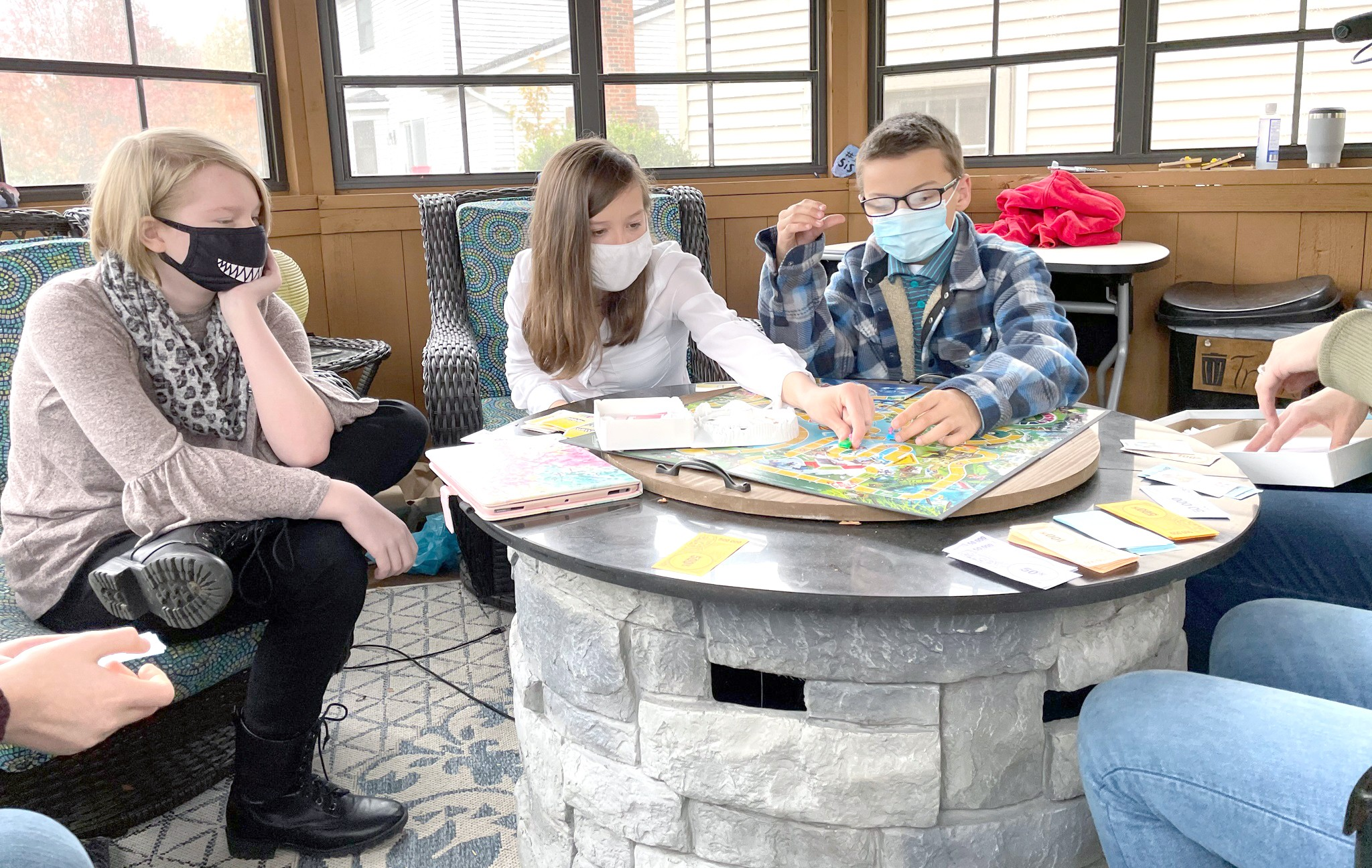 Kids at a family gathering play a game together while wearing masks. A new survey by The Ohio State University Wexner Medical Center finds nearly two in five report they will likely attend a gathering with either more than 10 people or people from outside their household. (Photo courtesy of The Ohio State University Wexner Medical Center)