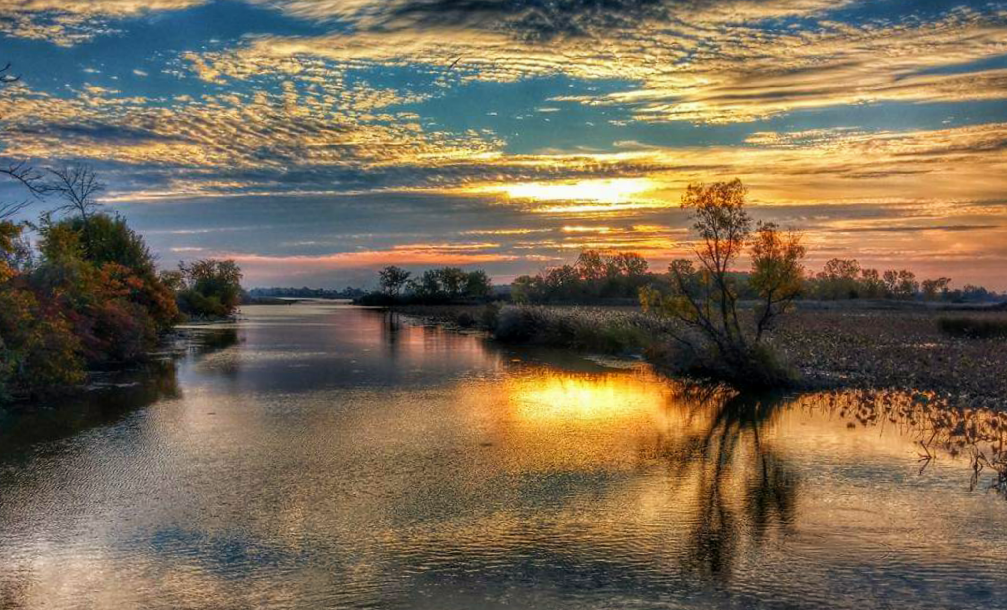 """Dave Smith's """"Crane Creek Sunrise"""" won the 2021 Best of Show Award in the 2021 Ottawa National Wildlife Refuge Photo Contest. The photo was taken on the ONWR Wildlife Drive. Cast a vote for the People's Choice Award at friendsofottawanwr.org."""