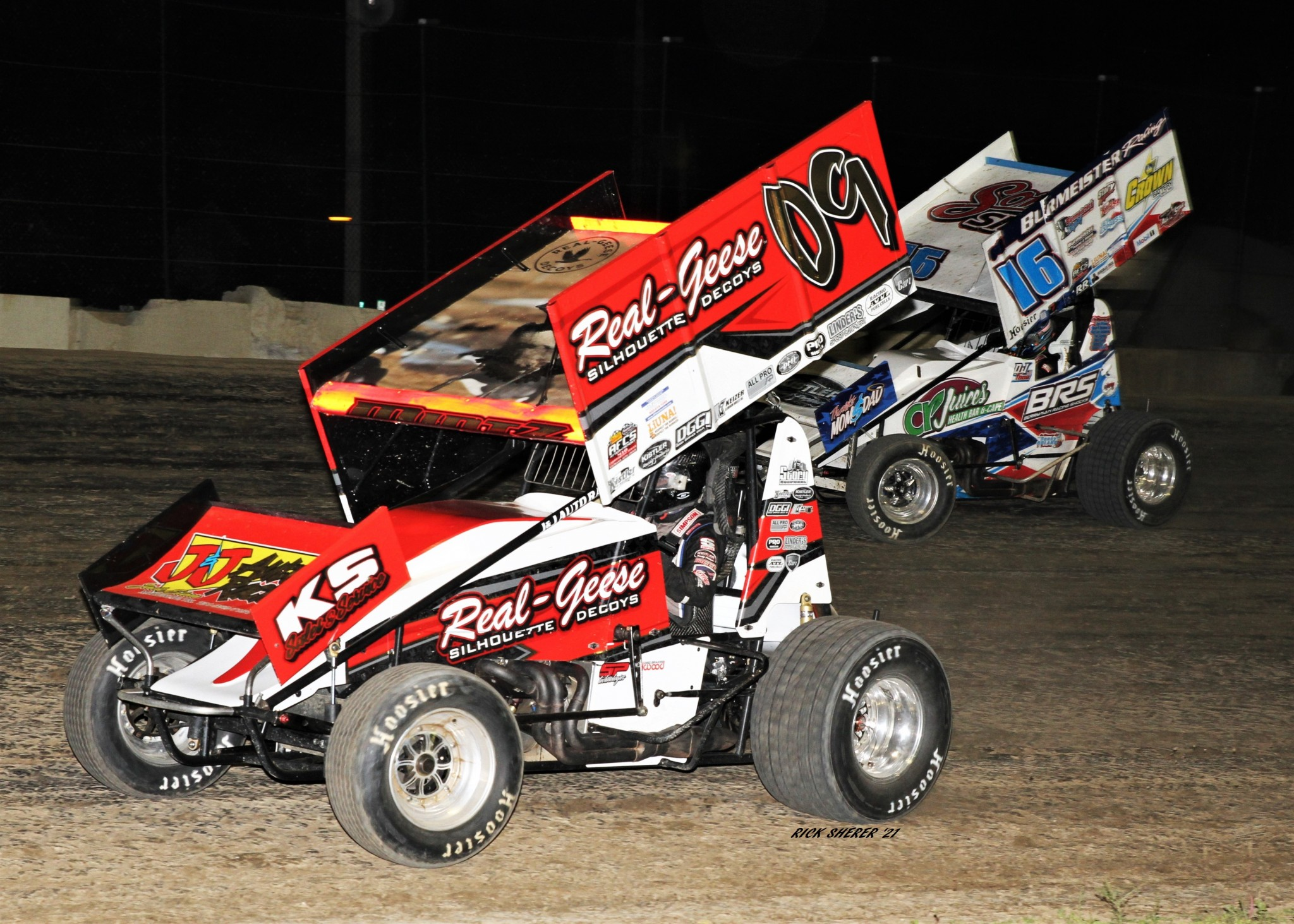 D.J. Foos (16) of Fremont would eventually overtake Craig Mintz (09) of Gibsonburg and win night one of the Attica / Fremont Championship Series at Fremont Speedway. Mintz finished 5th. (Photo by Rick Sherer)