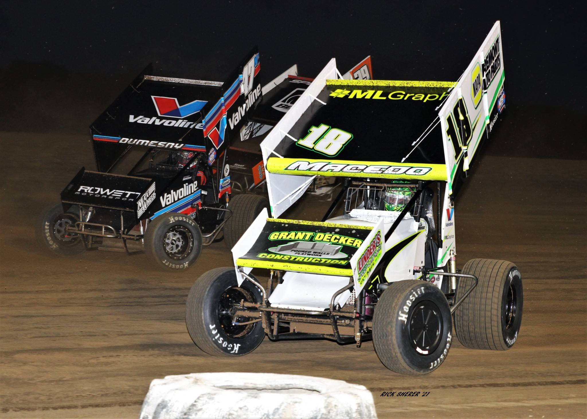 The 18 car owned by Gibsonburg's Ray Brooks and driven by Cole Macedo battles early on with Australian Marcus Dumesny (47) and NASCAR's Christopher Bell (39), but Lebanon, Indiana's Spencer Bayston (11) ran away to win the World of Outlaws Brad Doty Classic at Attica Raceway Park.  (Photo by Rick Sherer)