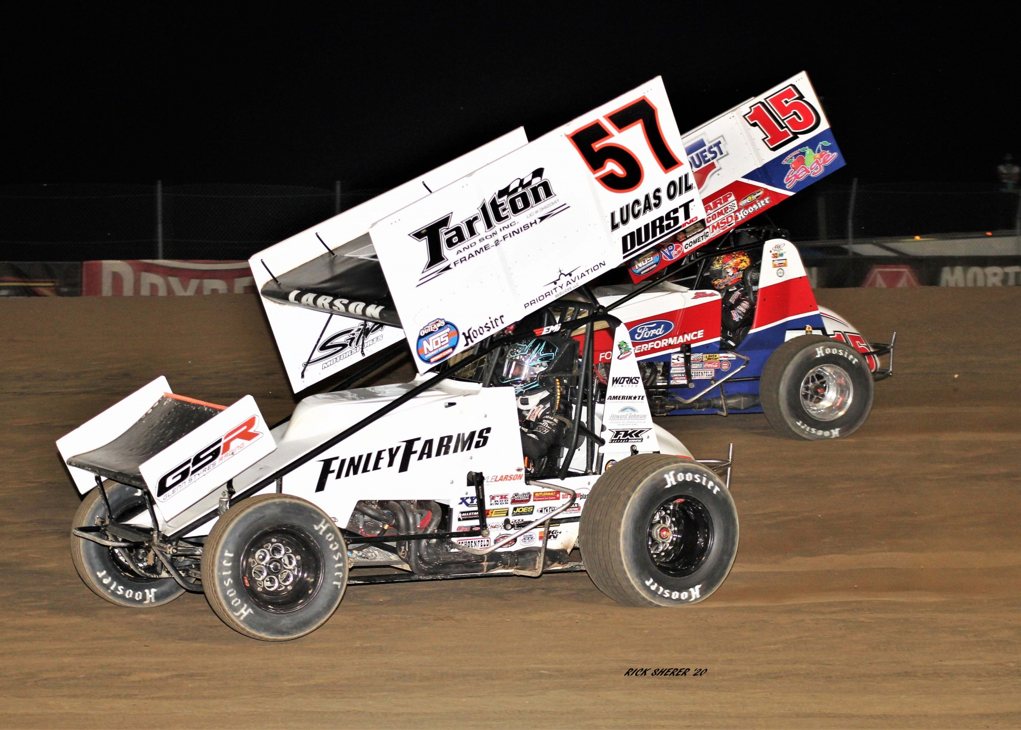 Kyle Larson (57) stayed a few steps ahead of many-time World of Outlaws champ Donny Schatz (15) and went on to win prestigious World of Outlaws Brad Doty Classic feature at Attica Raceway Park. Schatz was second. (Photo by Rick Sherer)