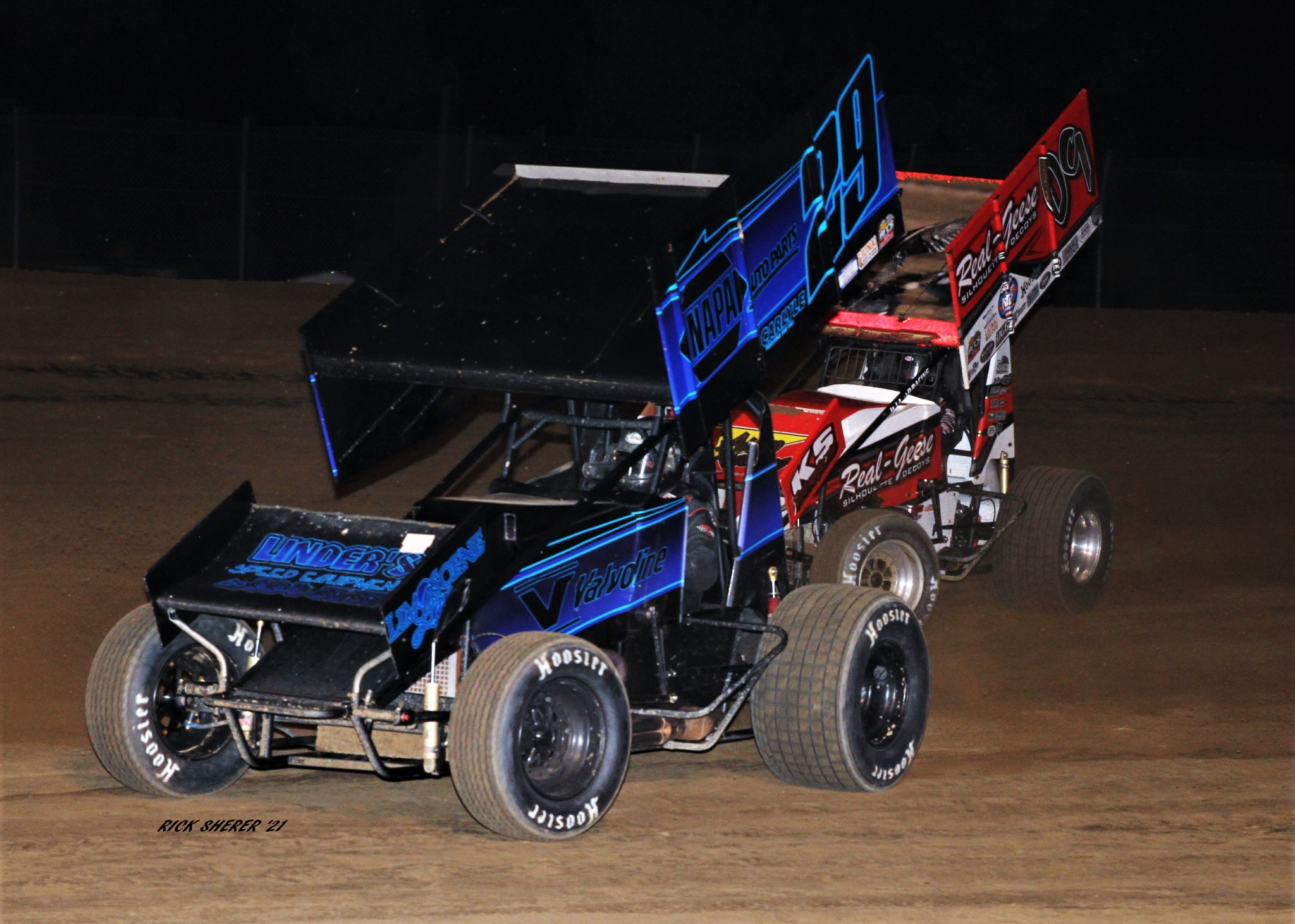 Gibsonburg wheelmen Stuart Brubaker (29) and Craig Mintz (09) go at it during the AFCS 410 Sprints feature at Attica Raceway Park. Mintz finished third and Brubaker was fourth. (Photo by Rick Sherer)