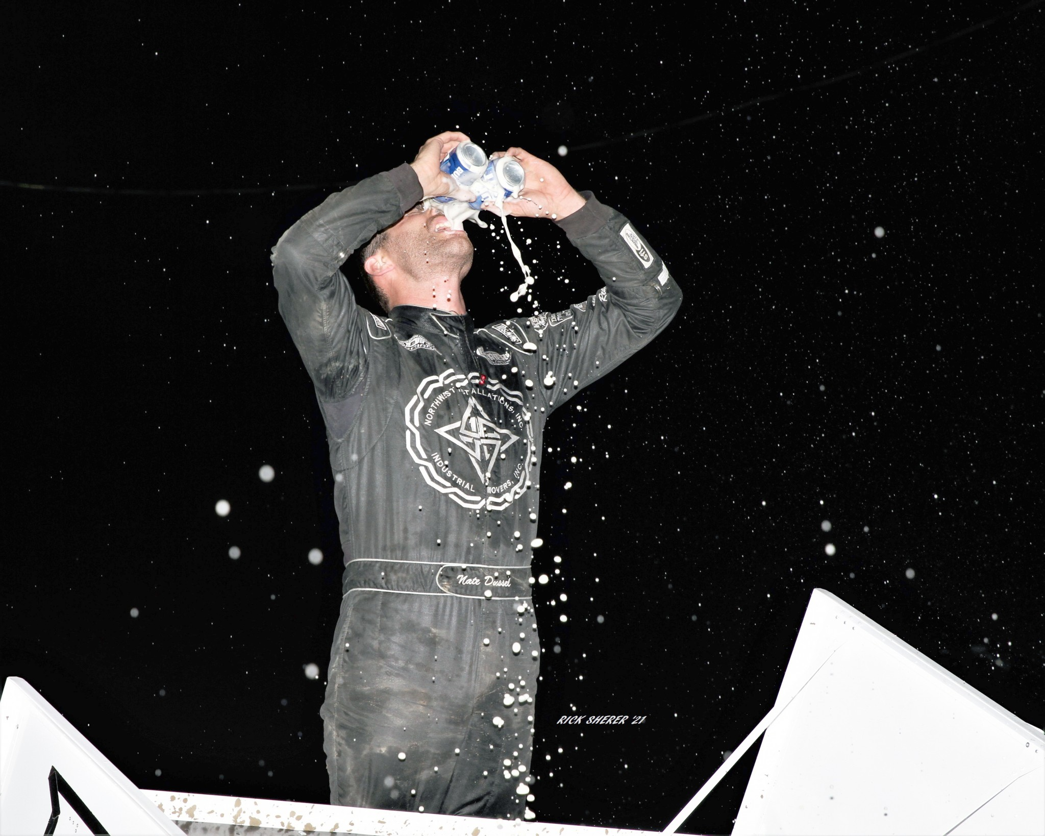 Nate Dussel has one of the most unique and intense victory celebrations around atop his wing with a pair of his favorite beverages. (Photo by Rick Sherer)