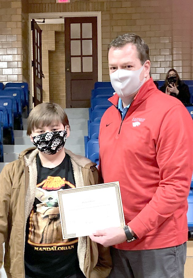 Eastwood Elementary student Rich Bauer with Principal Joe Wank. Eastwood Schools Board of Education honored Bauer at their January meeting for the youth's generosity in helping the Angel Tree program sponsored by the Luckey and Pemberville Food Pantries. (Submitted photo)