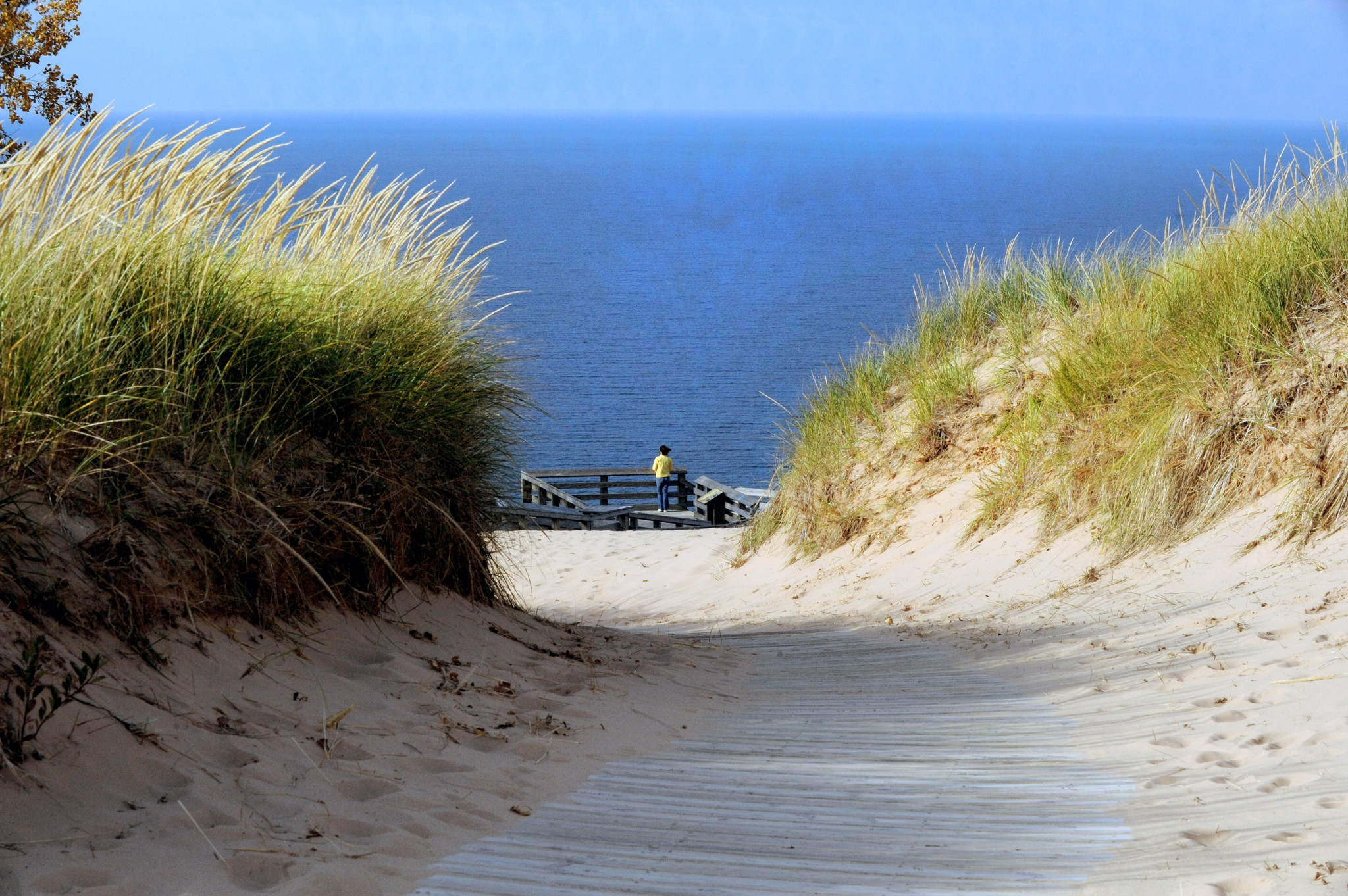 The Leelanau Peninsula is a prime example of an excellent close-to-home destination. Beautiful scenery, great accommodations and so much to experience. The dunes are immense; the overlooks and their open view of the blue waters of Lake Michigan are spectacular. (Photo by Art Weber)