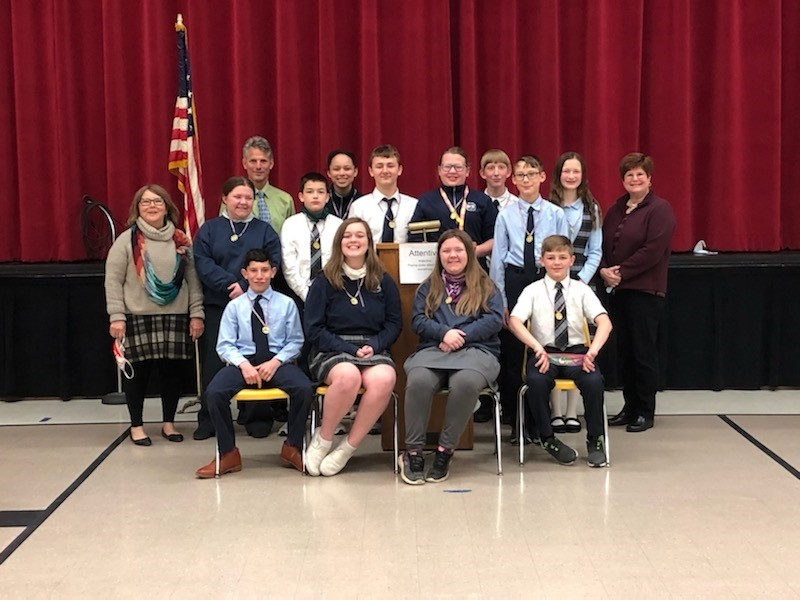Toastmasters Kathy Varga (standing, far left), Jim Taylor (back row) and Julie Selvey (far right) with St. Boniface Youth Leadership Program graduates. (Submitted photo)