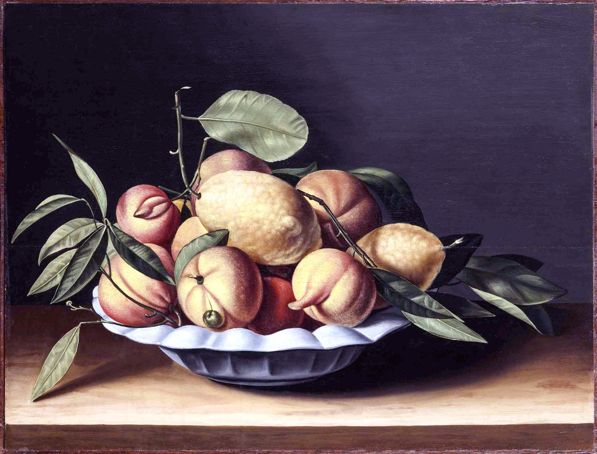 """French painter Louyse Moillon's oil on panel """"Still Life of Citrons and Curaçao Oranges in a White Polylobed Dish. (Photo courtesy of Toledo Museum of Art)"""