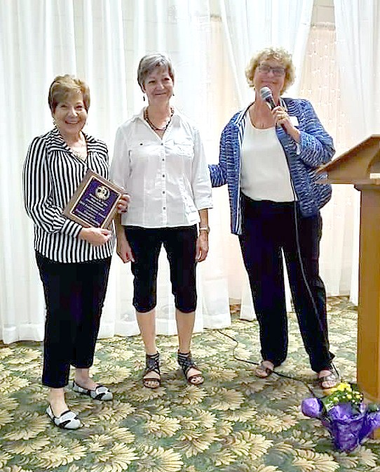 S. Jean Varwig Clark, on behalf of the Waite High School Alumni Association, presented a Pathfinders Award for 2019 to Carolyn Urbanowicz  and Mary Wiezbenski, Sunrise Banquet Center and Carolyn's Catering. (Submitted photo)