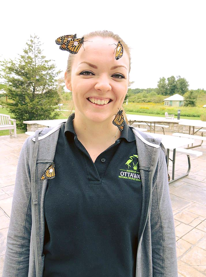 Executive Director Aimee Arent releasing several tagged butterflies at Ottawa National Wildlife Refuge as part of a citizen science effort to learn more about their 3,000-mile migration. (Photo by Theresa Emahiser)