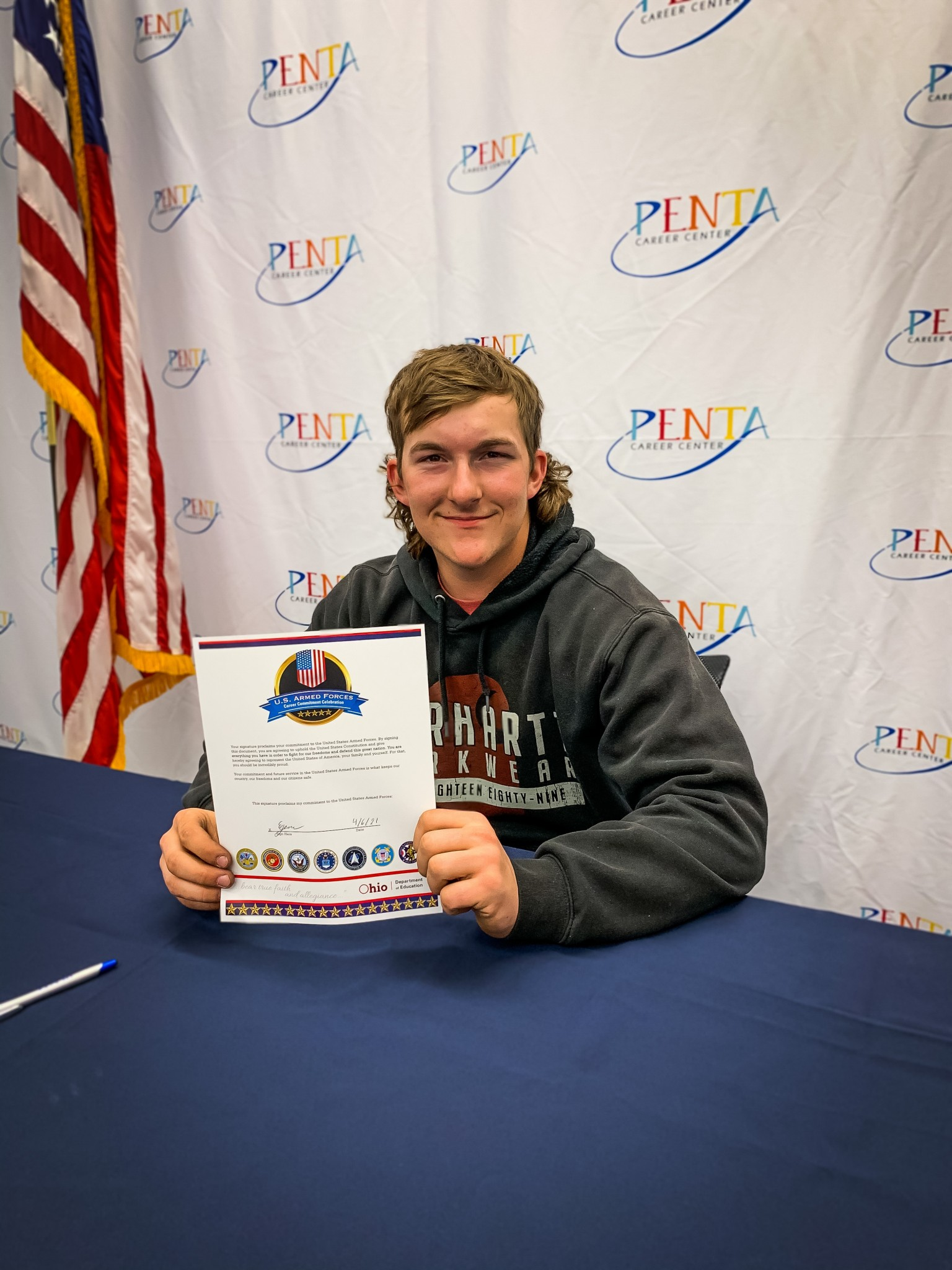 Oak Harbor Penta Career student Egan Bolander signs his commitment to the U.S. Marines. (Submitted photo)