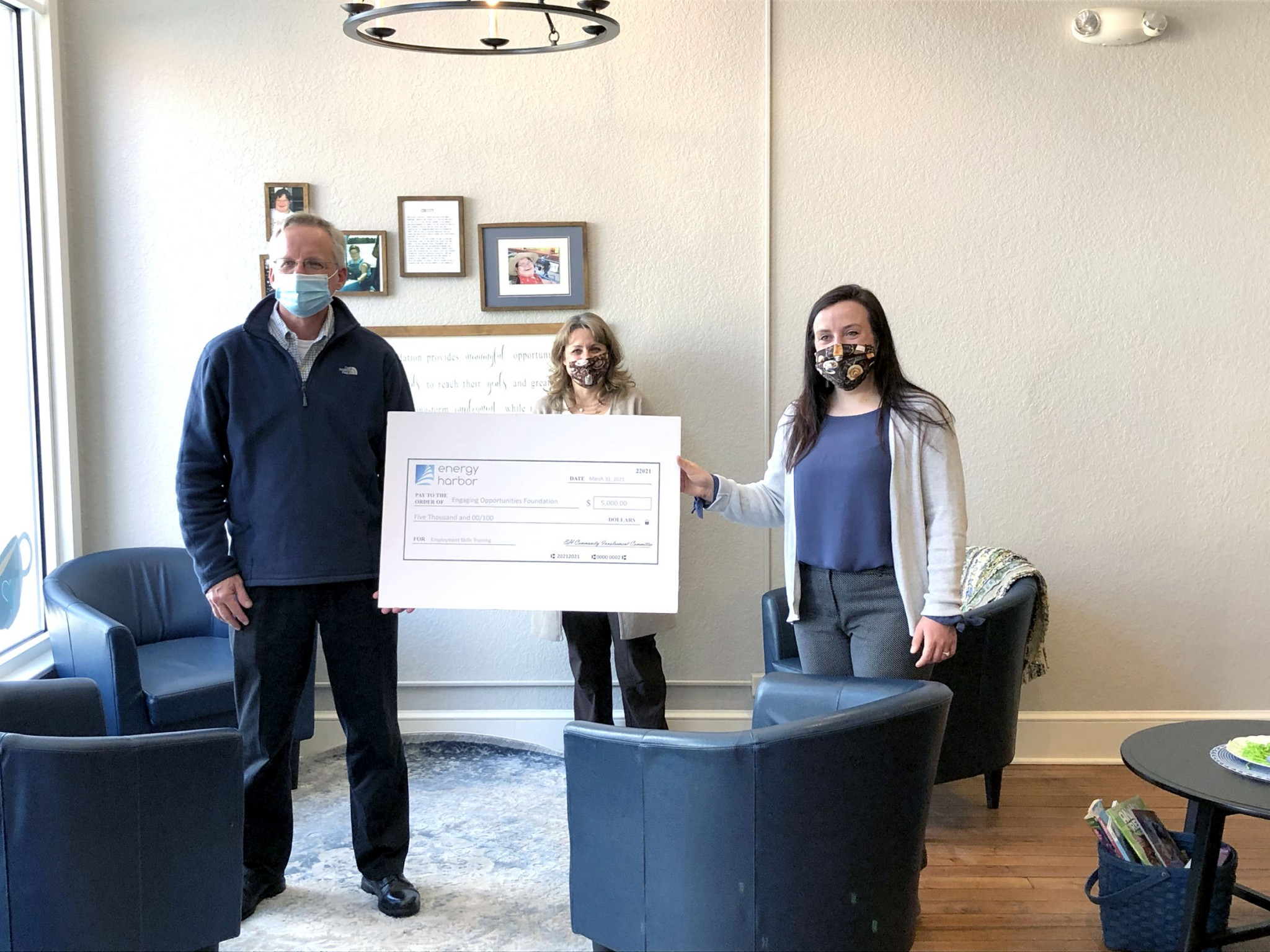 Doug Huey, plant  manager for Davis-Besse Nuclear Power Plant presents a check to Madeline Hines, board member for the foundation and Lead Job Coach for Christy's Corner, while Kathy Barbee, Executive Director of Engaging Opportunities Foundation looks on. (Submitted photo)