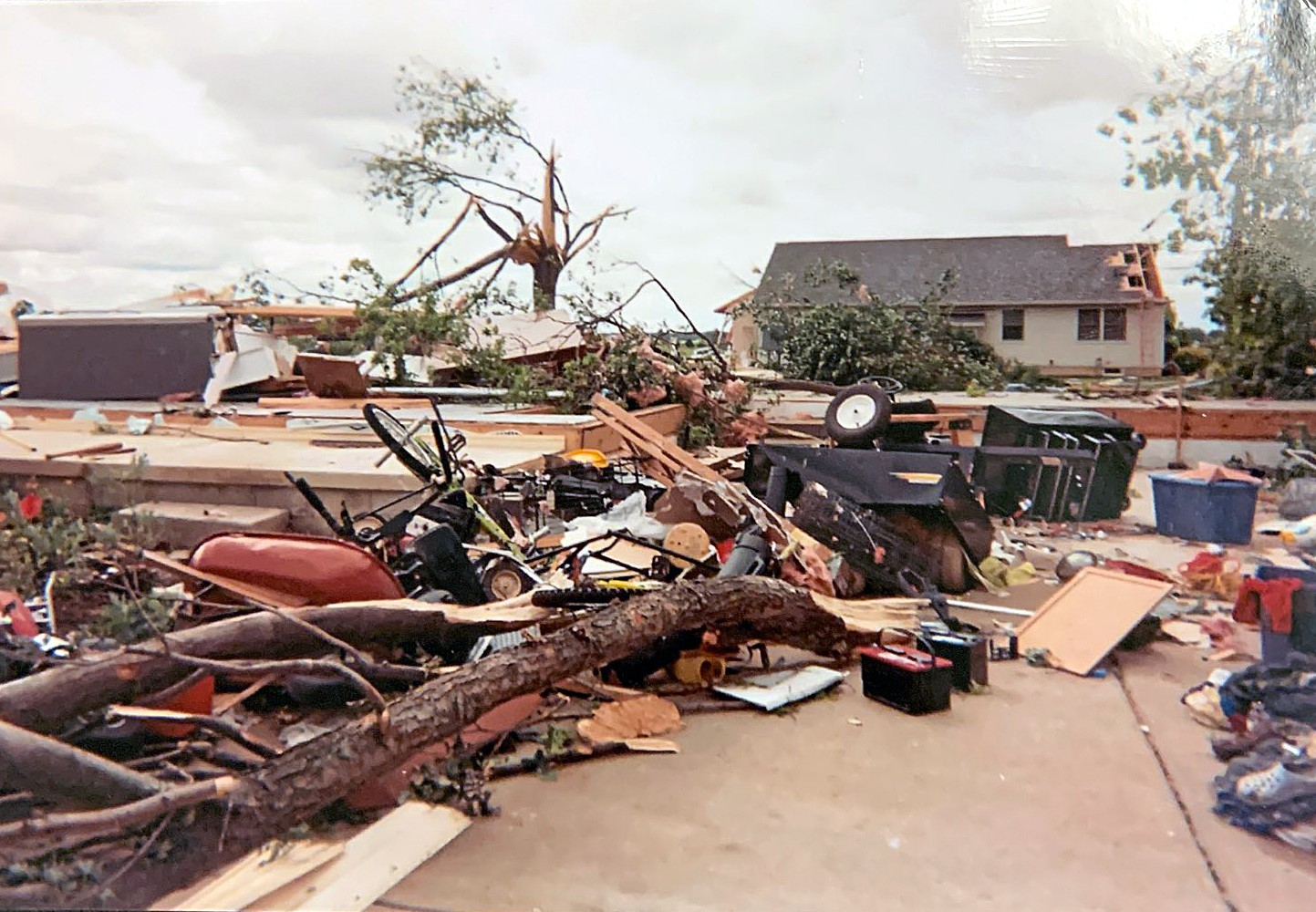 """""""Then all of a sudden, we smelled gas. Hot water was pouring down onto our shoulders,"""" said Sue LaVoy whose Neill Avenue home in Moline was leveled by the tornado. (Photo courtesy of Sue LaVoy)"""