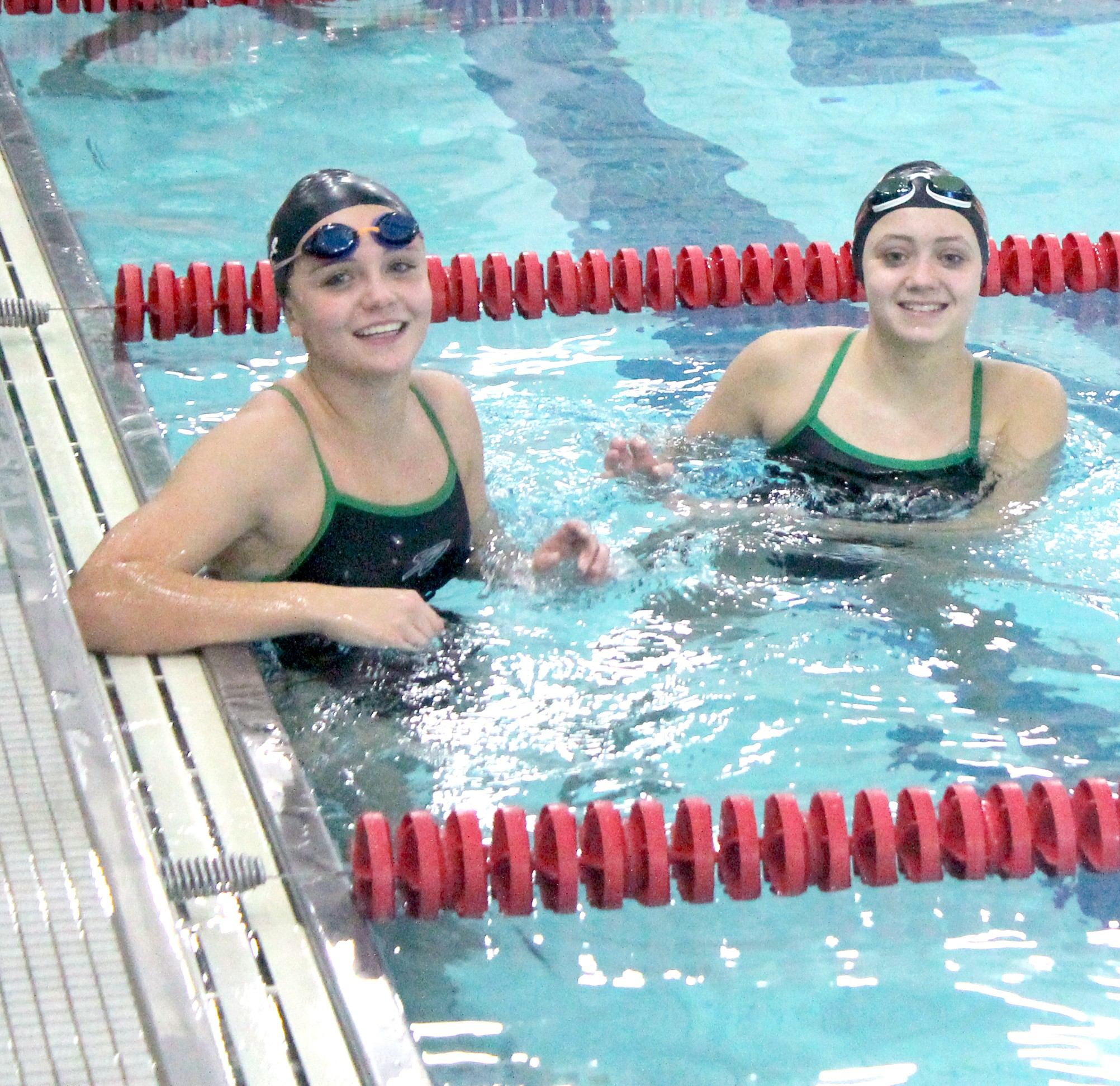 Oak Harbor swimmers Elayna Krupp and Alyse Sorg. (Photo courtesy Andrea Sorg)