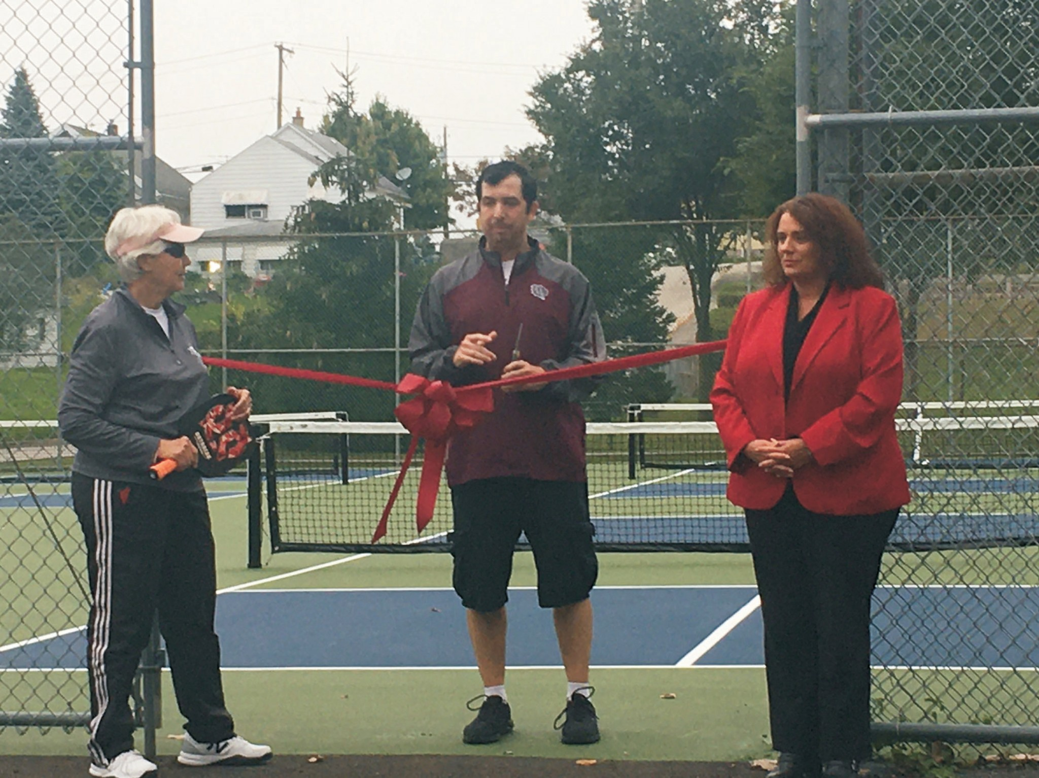 Connie Mierzejewski, fouding member of the Toledo Pickleball Club, Rossford Recreation Director Toby Ledesma and Rossford City Administrator Allyson Murray.